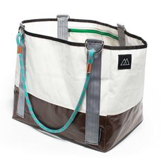 Our best selling Deluxe Zippered Tote bag features a zippered top closure, two zippered interior pockets, fully lined sail cloth inside and a rugged tarp exterior. If this tote could talk it would tell of great adventures from coast to coast. The next chapter is yours.