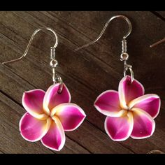 CuteHawaiian flower earrings These adorable magenta plumeria flowers are made out of clay. Each flower is about the size of a penny. Perfect for spring and summer! Jewelry Earrings