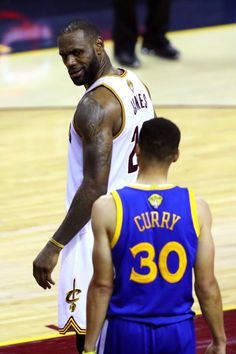 LeBron James looks at Stephen Curry after blocking a shot in Game 6 of the 2016