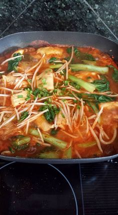 Spicy Kimchi Soup with Dumplings and Veggie   http://belachan2.blogspot.com/2015/12/spicy-kimchi-soup-with-dumplings-and.html