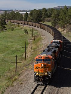 https://flic.kr/p/HwXLD7 | BNSF 6175 Monument 22 May 16 | BNSF 6175 leads a southbound coal train around the curve and under the Baptist Road overpass near Monument, CO.