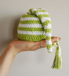 I'm such a sucker for stripes and baby stocking caps. Crochet baby elfin hat by MomoMushy (Flickr)