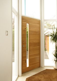 A front door is the most important piece of design at your entry area. Here are awesome modern front door designs that might inspire you to make it stylish. Contemporary Front Doors, Modern Front Door, Wood Front Doors, Modern Wood Doors, Modern Entry, Timber Door, Door Design, House Design, House Doors