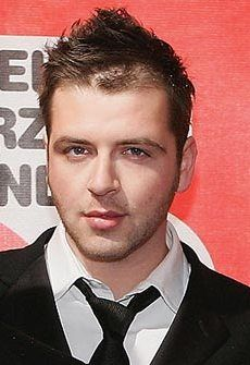 Mark Feehily (born Marcus Michael Patrick Feehily, 28 May 1980) is one of the lead singers of the former Irish boyband Westlife.  In August 2005, he publicly revealed he was gay during an interview with the British tabloid The Sun.[5] Mark had recognized his sexual orientation when he was 14 or 15 years old. During the interview with The Sun, Mark also announced his romantic relationship with British fashion photographer Kevin McDaid, a member of the now-defunct British boy band V.