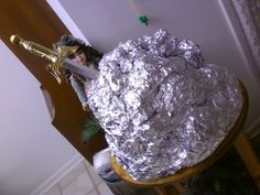 castle classroom door theme..sword in the stone.. made from tin foil with plastic sword stuck in middle