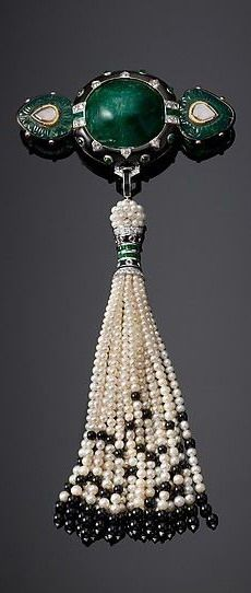 Shoulder Brooch by Cartier, circa 1924. Pendant tassel re-created from original records by Cartier workshops, Paris, 2012. Brooch, platinum, set with emeralds, diamonds, enamel and gold; tassel: pearls and onyx beads
