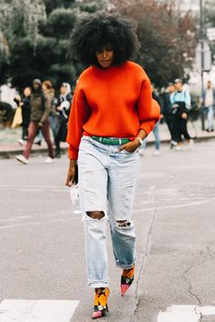 Orange sweater distressed jeans colorful pumps