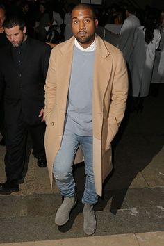 Kanye West has been papped in an array of drool-inducing overcoats lately but number one has to be this denim-complementing camel-coloured number.