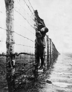 A Russian prisoner of war, shot whilst trying to escape from a German prison camp. Nazis left his body on view as a warning to others, circa 1943.