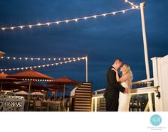 South Jersey & Philadelphia Wedding Photographer - Allison McCafferty Photography, LLC - The Reeds Wedding Photo: Having a wedding at the Reeds at Shelter Haven is a dream! &nbsp,The outdoor ceremony on the docks at sunset was beautiful followed by an indoor reception for their closest friends and family. &nbsp,We ended the night with a shot under the string lights outside. &nbsp, Location: THE REEDS AT SHELTER HAVEN, 9601 THIRD AVENUE, STONE HARBOR, NJ 08247.
