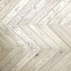A modern take on a traditional herringbone wood floor - perfect for modern French kitchens