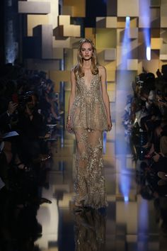 Elie Saab Fall 2015 Couture: Gold bead work is fabulous! I like the peplum top with the sheer skirt with even more beading.