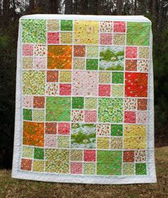Image result for quilt designs using large scale print layer cakes