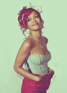 Rihanna. One of my fave pics of her. Adore the red hair and love the outfit.