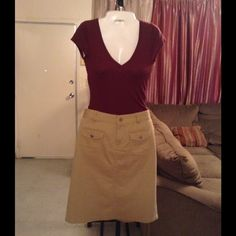 """POLO By Ralph Lauren Skirt Polo skirt is made of 96% Cotton and 4% Spandex. Size 6. The color is a Khaki/Tan. 2 Snap pocket front. Length """"24. Laying flat """"15. This item is NOT new, It is used and in Good condition. Authentic and from a Smoke And Pet free home. All Offers through the offer button ONLY.  Ask any questions BEFORE purchase. Please use the Offer button, I WILL NOT negotiate in the comment section. Thank You Polo by Ralph Lauren Skirts"""