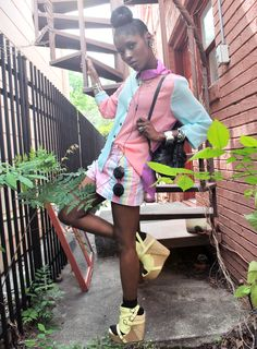 I absolutely love how the vibrant blouse, plaid shorts, and canary wedges represent a perfect combination of pastel hues and the addition of edgy accessories prevent this look from appearing too saccharine.