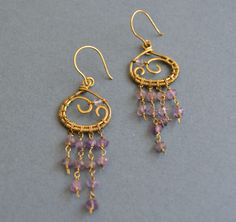 A personal favorite from my Etsy shop https://www.etsy.com/listing/522270127/amethyst-antique-brass-earrigns-purple