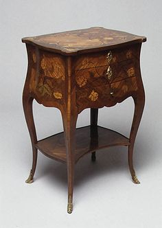 Small table (Table en chiffonière) Maker: Jean-Charles Saunier  (1735–1807, maître ébéniste 1743) Date: ca. 1755 Culture: French Medium: Walnut, oak and pine, purplewood, satiné wood, mahogany, engraved boxwood and stained woods, gilt-bronze