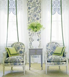 Soft, subtle colors. The green piping detail on the curtains draw your eye upwards.