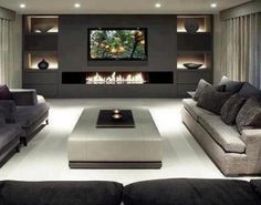 dramatic contemporary living room with charcoal feature wall with television and long, low fireplace