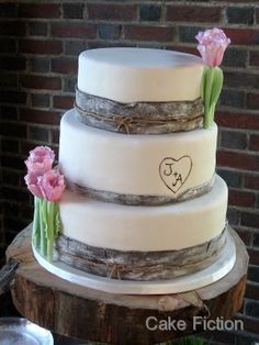 Birch Wood Theme Wedding Cake - No standing flowers, just flowers sitting and the heart initial background in red