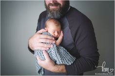 dad and newborn son - father son pose with baby