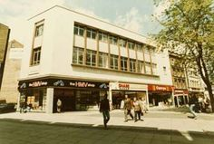 Photograph taken from the entrance to Broadmarsh Shopping Centre June 1986. Shows new shop units in converted Woolworths store, and Sawyers Arms public house (next to the tree) which is no longer there.