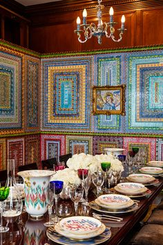 The dining room's marquetry-inspired panels are actually a 2009 artwork made of discarded lottery tickets collected and repurposed by artist duo Ghost of a Dream (Adam Eckstrom and Lauren Was).