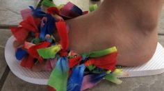 With fabric... cut fabric straps and make a knot.... and you will have a new flipflop.... fun for kiddos y summer time!