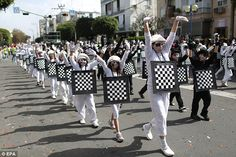 Check mate: Israeli children dressed as a chess board join the parade to celebrate Purim in Israel