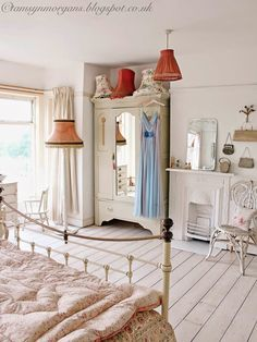 Dreamy bedroom...vintage lamp shades are the business.