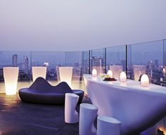 Frameless glass rail adds to an open-air experience at the Aer bar in Mumbai.