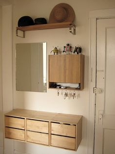 The Back Garage apartment dwellers used simple components from Ikea to create this entryway storage system.