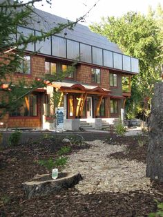 The Riverdale Net Zero Project, a duplex located in Alberta, Canada, produces electricity via a photovoltaic array, a solar hot water heating system, and passive solar gains.