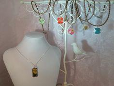 Real flowers embedded in pendants