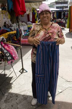 """A woman in Otavalo, Ecuador selling a few pairs of """"jungle pants"""" jungl pant"""