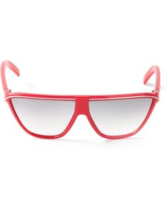 Red flat top sunglasses from Gianni Versace Vintage featuring curved bottom frames and slender arms.
