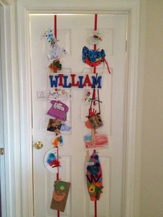 Cute way to display kids artwork without having it all over your house. Wrap ribbon around the door, staple ribbon together, and add little clothespins. No marks on the door when you decide to take it down, just pull the stapled end of the ribbon apart.    The kids can choose what to display for others on the front of their bedroom door and for themselves on the back of the door.