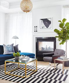 Eclectic living room design with statement  black and white rug and gold accents | Jennifer Ferreira