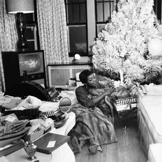 Dinah Washington savoring a few of her Christmas gifts under the tree in 1958. Photo: Isaac Sutton/Ebony/Art dot com.