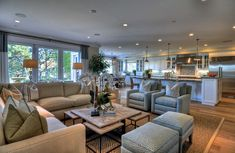 Traditional Family Room Design with Cream Sofa Sectional and Rustic Oak Coffee Table also Gray Armchairs on Carpet