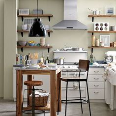 Paul and I both covet this kitchen. Shelves, fume hood, stool, island, sink, stove, colors.