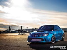 Chris Dunbar's 2006 Subaru WRX STI. Hands down the cleanest STI I've ever seen. Also another car I'd like to own one day.
