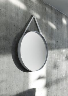 HAY Strap Mirror by HAY Studio. HAY Strap Mirror is a mirror suitable for any environment. It has a powder-coated steel frame and a cool silicone grey strap. It is available in two sizes - diameter or diameter. Hay Design, Design Shop, House Design, Circular Mirror, Round Mirrors, Grey Mirrors, Mirror Mirror, Mirror Hanging, Bathroom Mirrors