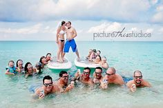 So we came up with this idea for those who want to Trash the Dress for their wedding BUT do not really want to Trash the Dress! So this is a PRE-WEDDING Trash the Dress. The whole bridal party joined these guys and the bride and groom in bathing suits stood on paddle boards with a veil for the bride and a bow tie for the groom. The groomsmen each had a corona!!!! So Fun!!!! Congrats to Meghan and Jarrod!