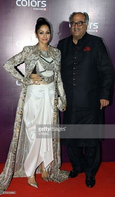 Indian Bollywood actress Sridevi Kapoor (L) poses for a photograph alongside her husband Boney Kapoor during a promotional event in Mumbai on late April 18, 2015.