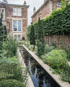 """Before & After: A Modern Courtyard Garden for a Historic Home A long, slim reflecting pool is one of two major water features in the project. """"They have a combined volume of five thousand cubic liters,"""" say the architects, and both are controlled by pumps"""