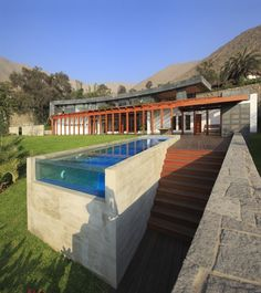 12 Modern Pools: CyD House by V.Oid Architecture in Lima, Peru features a pool with side walls built up of concrete and mosaic blue tiles inside.