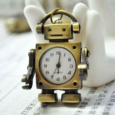 Dont forget to #accessorize! This super cute #robot #necklace doubles as a watch. http://ift.tt/2iJea9t
