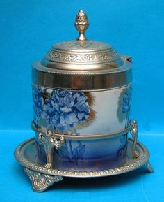 1219: Victoria ware biscuit jar, in S.P. footed stand, : Lot 1219